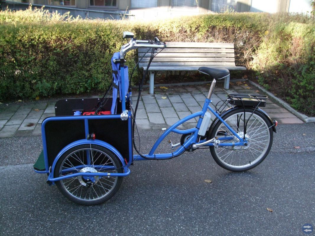 3-hjulig elcykel anpassad för barntransport