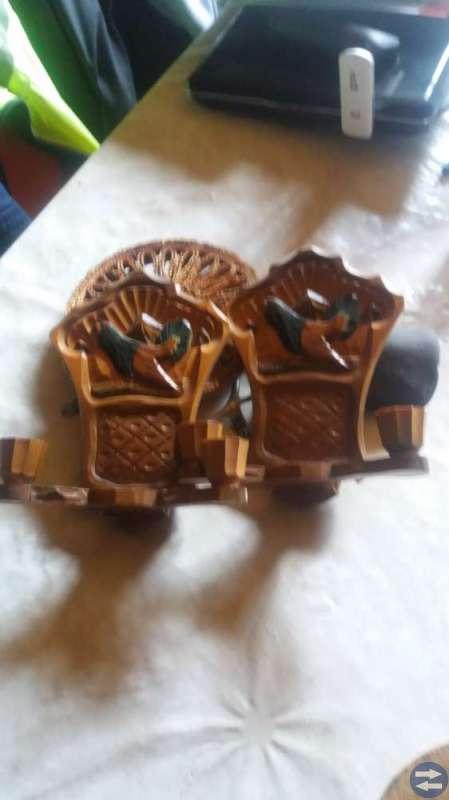 Två träsnidade lampetter