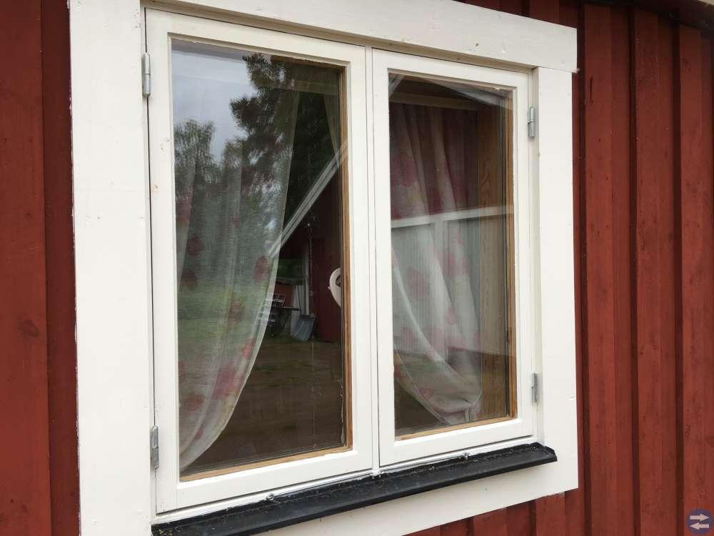 Fönster med fönsterkarm