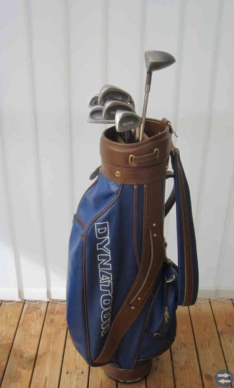 Golfklubbor och vagn