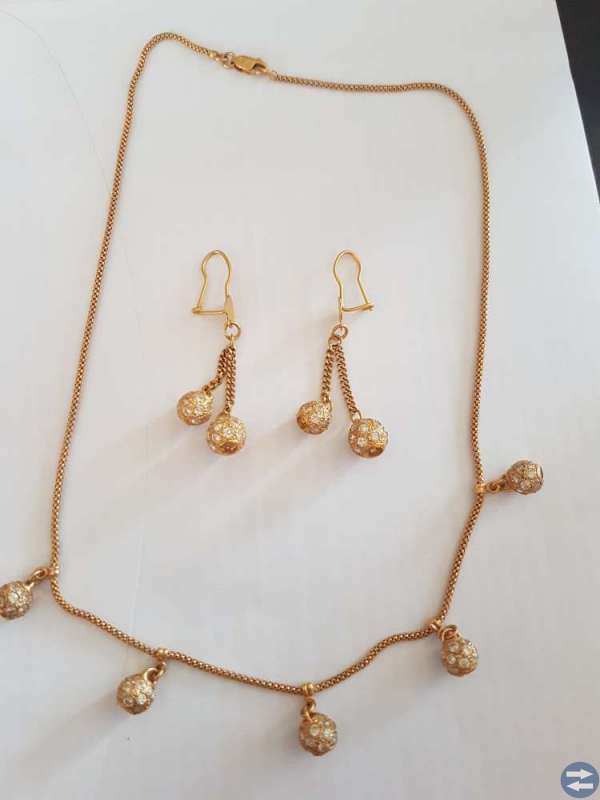21 karat guld smyckesät