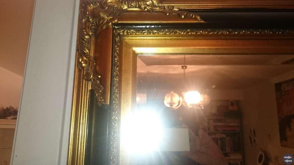 Rustik fin guld och svart spegel i gammal design