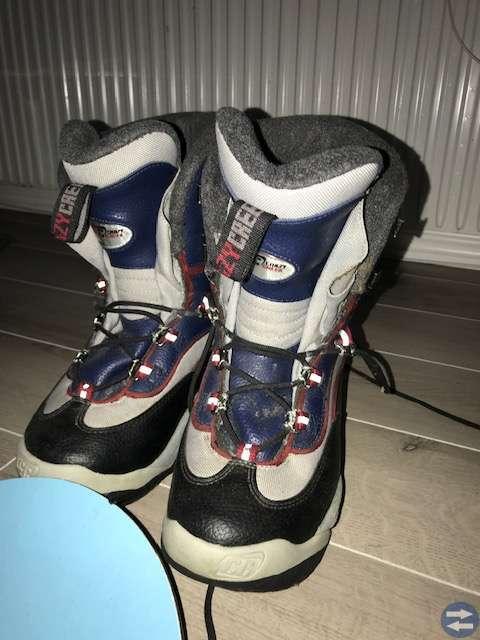 Snowboard och slalompaket