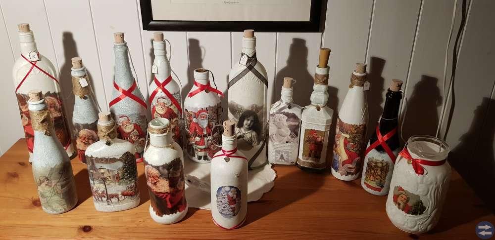 Ljuslyktor av flaskor. Julmotiv. Julklapp