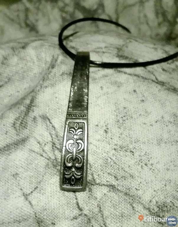 Handgjorda smycken av silversked