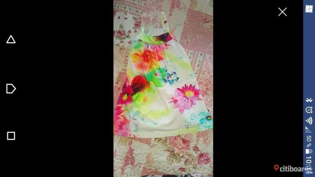 Molo klänning stl 98/104
