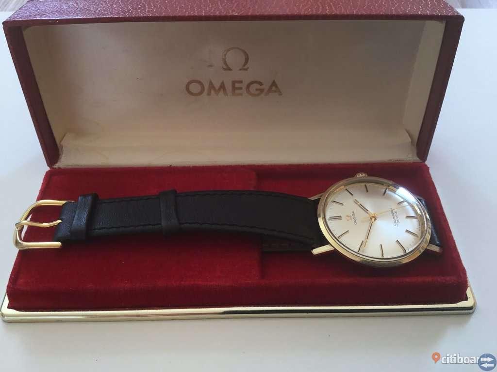 KLOCKA: Omega Seamaster De Ville guld på stål Bytes / Säljes